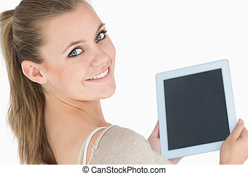 Smiling woman showing a screen tablet