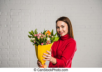 woman showing bouquet of flowers