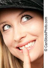 Smiling woman showing shush
