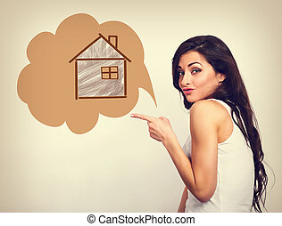 Smiling woman showing the hand on small illustration wooden house in bubble. Insurance protection concept or investment to safety money. Vintage color style