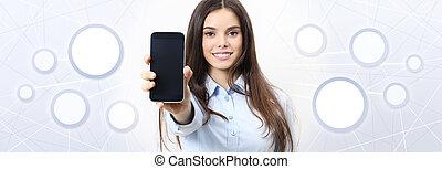 Smiling woman shows smartphone, social media, social network concept
