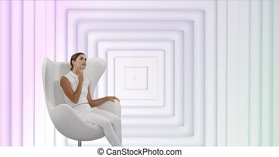 Animation of smiling woman sitting in white armchair with white squares pulsating in seamless loop in the background. Movement and abstract concept digital composite.