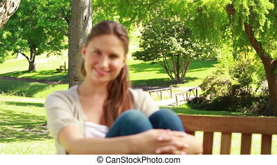Smiling woman sitting on a bench