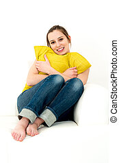 woman sitting on her sofa