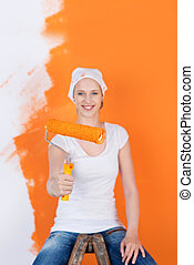 woman sitting on ladder and renovating flat