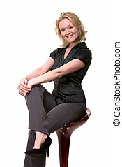Smiling woman sitting on stool