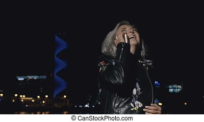 Smiling woman speaking on phone