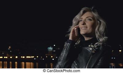 Smiling woman speaking on phone