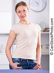 Smiling woman standing at home