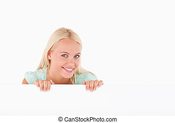 Smiling woman standing behind a whiteboard
