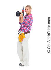 Smiling woman standing holding a d