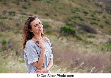 Smiling woman standing in nature