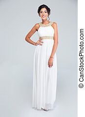 Smiling woman standing in trendy dress