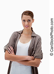 Smiling woman standing with folded arms