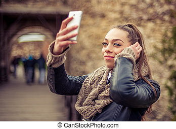 Smiling woman taking a selfie with