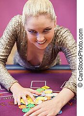 Smiling woman taking chips