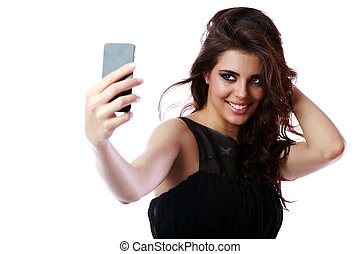 Smiling woman taking self picture with smartphone camera
