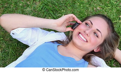 Smiling woman talking on her cellphone