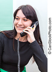 Smiling woman talking on telephone