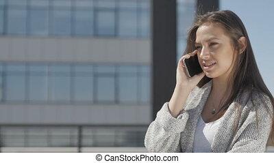 Smiling woman talking phone