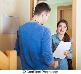 Smiling woman talking with man