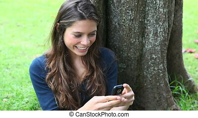 Smiling woman texting