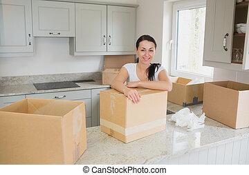 Smiling woman unpacking