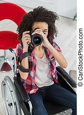 smiling woman using a camera
