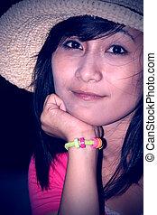 smiling woman using a cap