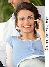Smiling woman using a cellphone