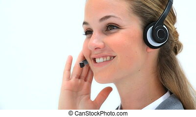 Smiling woman using a headset