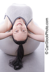 smiling woman using exercise ball