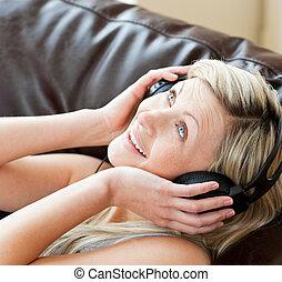 Smiling woman using headphones