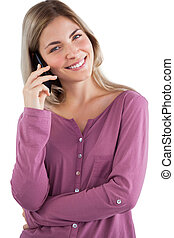 Smiling woman using mobile phone