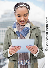 Smiling woman using tablet