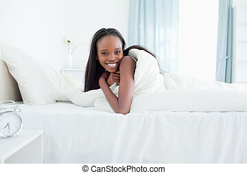 Smiling woman waking up
