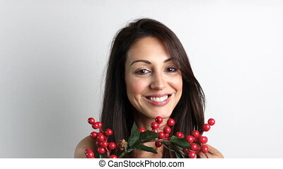 Smiling woman wearing a Christmas wreath on her head