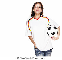 smiling woman wearing football shirt with football under her arm on white background
