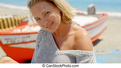 Smiling Woman Wearing Grey Sweater at Beach