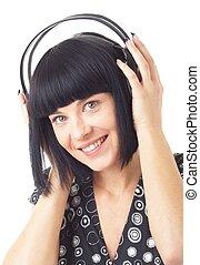 Smiling woman wearing headphones