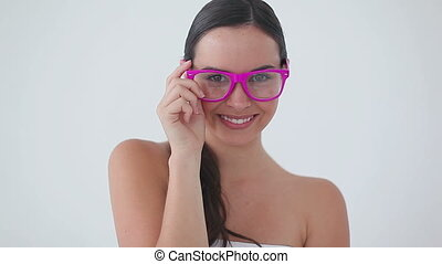 Smiling woman wearing pink glasses while laughing