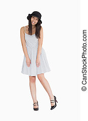 Smiling woman wearing polka dot dress