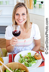 Smiling woman with a glass of wine