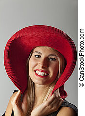 smiling woman with a hat