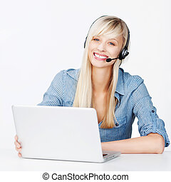 Smiling woman with a notebook and headset