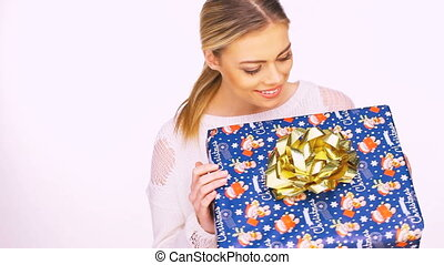 Smiling woman with a present