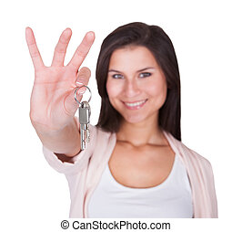 Smiling woman with a set of keys