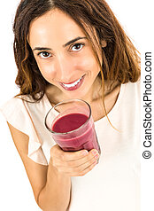 Smiling woman with a smoothie glass in her hand