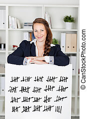 Smiling woman with a tally card