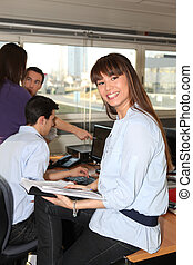 Smiling woman with an office diary